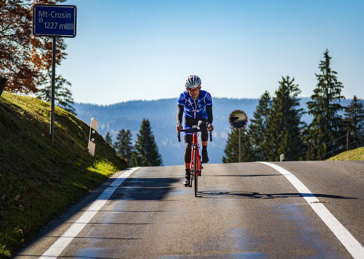 One male cyclist at the top of Mont Crosin in Canton Bern, Switzerland