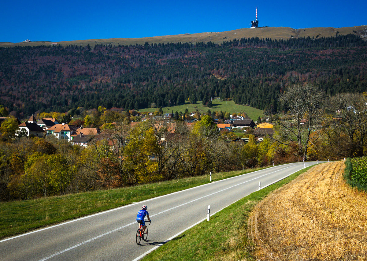 One male cyclist riding at the foot of Mont Chasseral in Kanton Bern, Switzerland