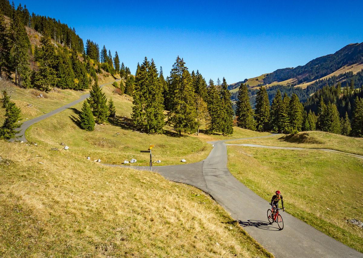 Lone cyclist climbing Mittelbergpass in Switzerland