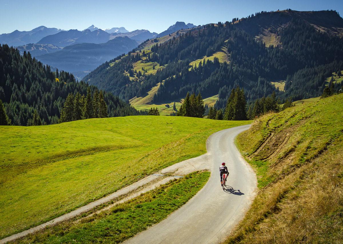 Lone cyclist descending Mittelbergpass in Switzterland