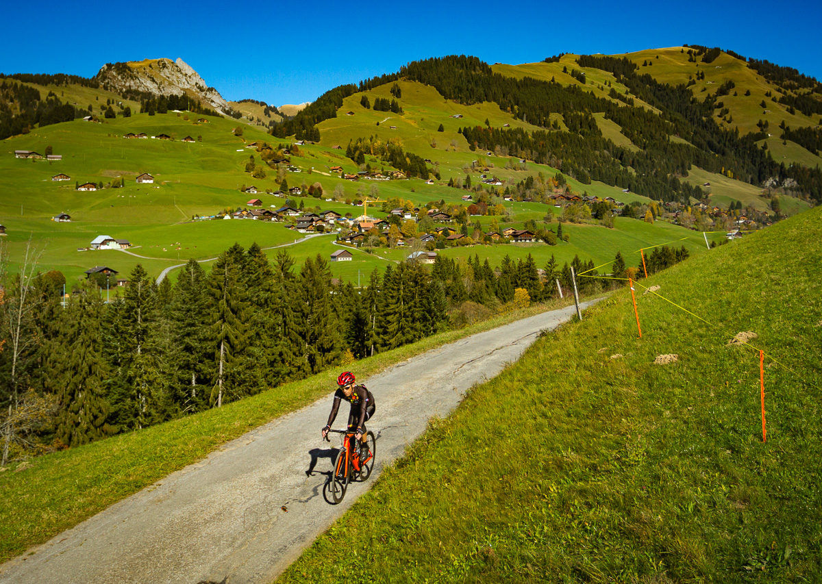 Lone cyclist riding in Pays d'Enhaut, Switzerland