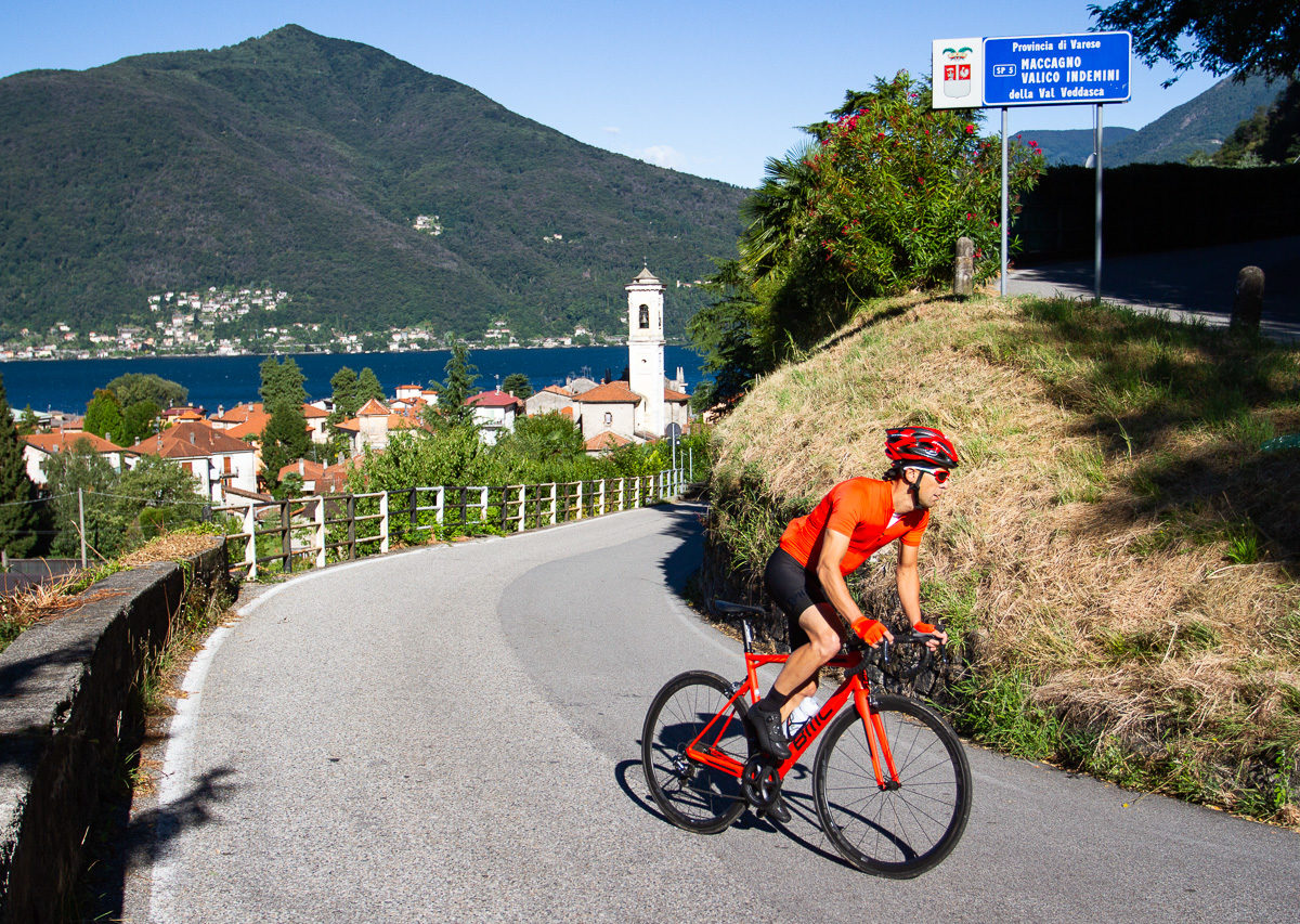 One male cyclist climbing on the Italian side of Alpe di Neggia in Ticino, Switzerland