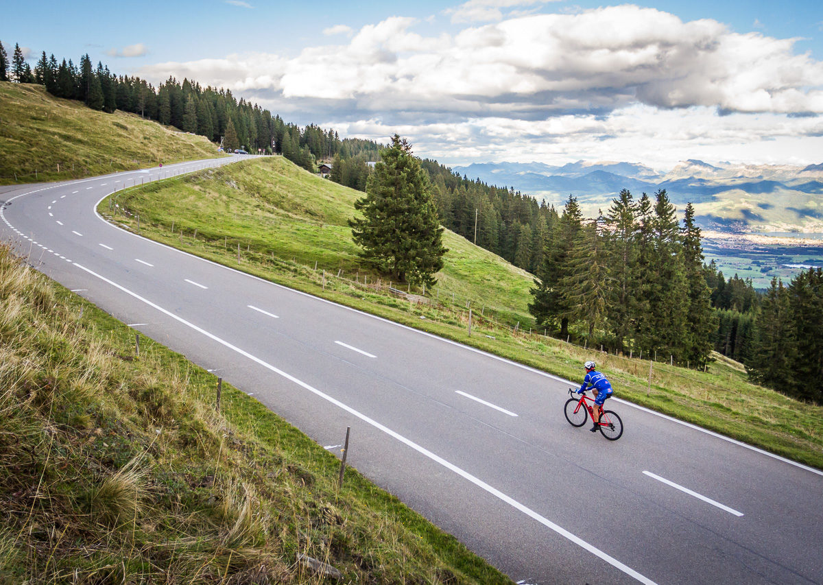 One male cyclist climbing Gurnigelpass in Kanton Bern, Switzerland