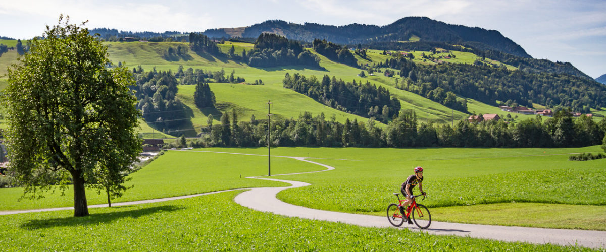 One male cyclist riding in Entlebuch, Switzerland