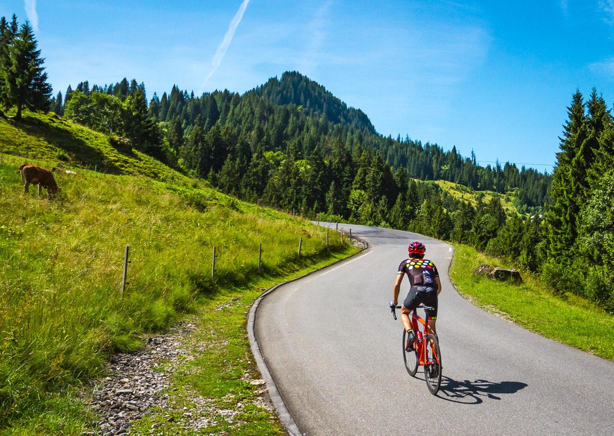 One male cyclist climbing Glaubenbergpass in Kanton Luzern, Switzerland